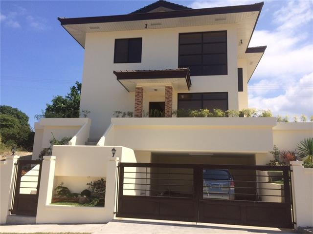 """Beautiful home in an exclusive,secured gated residential community in """"BATANGAS"""",Philippines developed by Landco. $250,000 (Canadian Funds).Out the front,you see a beautiful Bamboo Park.The upper back deck has a view of the luscious rolling green hills w/a partial view of the South China Sea.This community offers the best swimming beach in Calatagan w/exclusive access to 525 mtrs of white sand.The beach clubhouse has enormous swimming pool w/cabanas,a kiddie pool/water park & restaurant.Other amenities:Amphitheatre Park,Central Park,cove & river pools, snorkeling,kayak & banana boats.The 18 hole Calatagan Golf Club is 10 min drive. *LANDCO is an upscale real estate developer of luxury homes, resort condominiums & leisure communities.Home offers 3 bedrms, 3 bathrooms,open kitchen to livingrm,granite counter tops,tile flooring & comes furnished.Dble covered carport for parking.Home was built in 2014 so its just like new but you don't have to wait to have one built as here it is! Beautiful gated community!"""