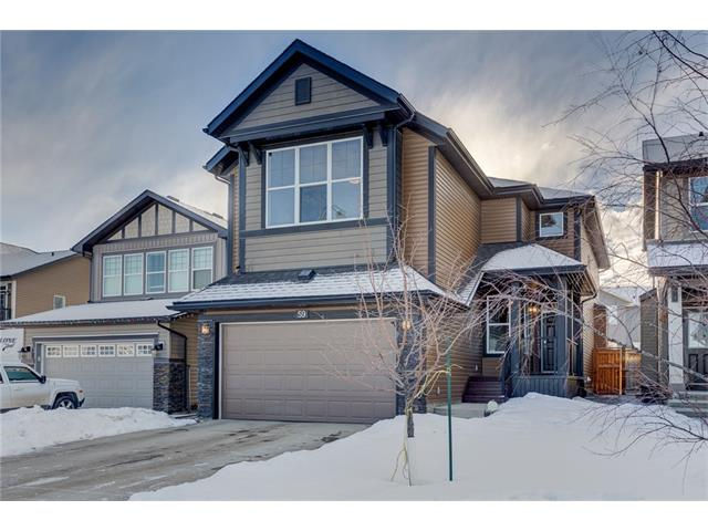 This large 2-storey home at over 2,300 square feet is well located across from a green space. The main floor boasts hardwood and tile flooring, open concept office/den area, grand living room with a ceiling 20 feet high, and gas fireplace with wood mantle and tile surround. The kitchen features a massive island, dark cabinets to ceiling height, and stainless steel appliances. The large nook shines with coffered ceilings giving you the ability to use it as a dining room as well. Off the nook is access to the southwest facing backyard complete with beautiful wood deck/patio with a walk down to a concrete block patio. Upstairs you have the spacious master bedroom and large master spa featuring his/her sinks, separate shower, soaker tub, and huge walk-in closet. Two more good sized bedrooms, 4-piece bathroom, and awesome bonus room with vaulted ceilings perfect for watching the big game or favourite movie. The unspoiled basement awaits your creative touch. Call your favourite Realtor to view today!