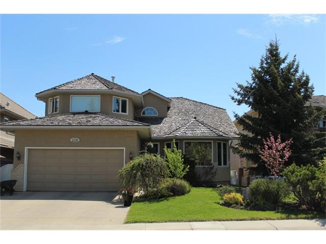 Located steps from Fish Creek,this lovely family home Welcomes you with its beautiful,landscaped curb appeal.Large great room with dining.4 over-sized bedrooms,3.5 bath & the luxury of a bright,walk-out basement,over 3520 sq ft of well designed,developed living space.Updated kitchen with granite...grab a coffee and enjoy the warmth of the morning sun on your east facing deck off of the kitchen nook.Adjacent to the kitchen a wood burning fireplace in the family room which flows easily with the open concept layout.All vinyl windows in the sunny home with Hunter Douglas blinds.Main floor custom built office and laundry with folding shelf and a sink.The master retreat is warm and spacious:walk in closet,dual vanities,jetted tub,separate shower & heated floors.Plenty of room in the lower rec room (roughed in wet bar),4th bdrm and storage galore-even a wine cellar!Oversized garage with built ins.Located close to transit.Walk out into your private,gorgeous,backyard oasis and relax-you are home!