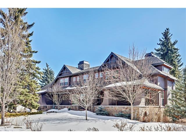 REMARKABLE ESTATE IN THE HEART OF BRITANNIA. Custom built, architecture by Marvin DeJong, interiors by McIntyre Bills. On the quality scale it's a 12/10. Huge lot, nearly 15,000 ft2, offering exceptional privacy + walkout rear yard w/ sunny south exposure. Open plan w/ rooms that are relaxed but beautifully detailed. Great room w/ wood-burning fireplace + TV on lift, dining room (built-in storage) + striking central kitchen (large adjacent walk-in pantry) all w/ access to huge covered rear terrace. Also on the main are a den + large office w/ FP. Extensive master suite w/ superb bath + enormous walk-in-closet.  Upper level also holds a 2nd bedroom, bath + large laundry. Sprawling walkout lower level features 2 bedrooms, rec room, media room, wine room + tremendous storage. Large flex space (currently hobby shop). RI elevator shaft to connect all 3 levels. Incredible infrastructure includes in-floor heat on all 3 levels w/ AC + humidity. Main level garage holds 4 on the floor (room for 2 lifts). Must see!