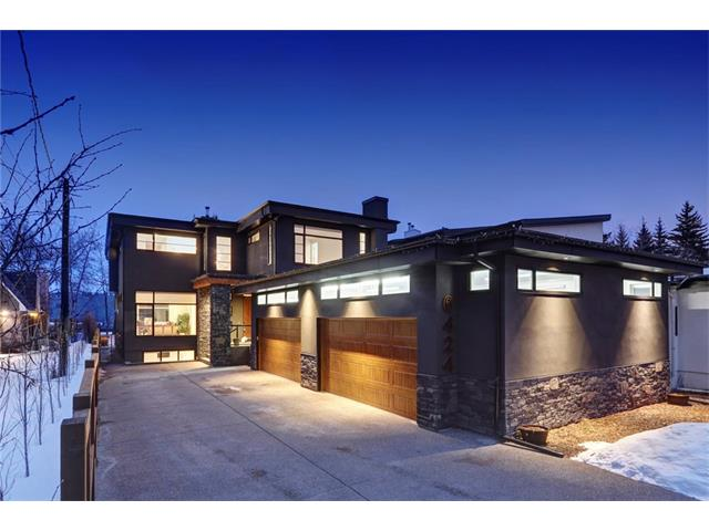 A one of a kind architectural masterpiece backing onto the Bow River, with close to 6,500 sf of development & positioned on a 15,000 sf private lot. A contemporary but sophisticated & luxurious feel throughout. Ideal for a growing family, with 5 large bedrooms. The master bedroom provides amazing views over the river. Ideal for entertaining, the main floor has an incredible open plan, but still has the formal rooms desired in a house of this calibre, and a vast array of windows & skylights allows for a bright & airy feel. Gourmet kitchen boasts top of the line appliances & 2 large centre granite islands. The fully finished basement has a large games room, separate media room, 2 additional bedrooms and a separate laundry room (ideal for a nanny or teenage kids). The 1300 sq ft attached 4 car garage is ideal for any car enthusiast and has the potential for lifts with 12? ceilings for additional vehicles/toys. From the back deck enjoy the private setting & fantastic views of the Bow River and Bowness Park.