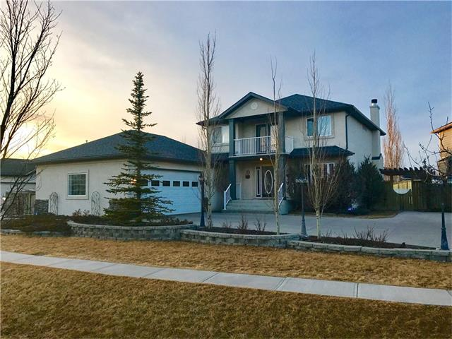 What an opportunity to own such a unique property in the heart of Airdrie!  Located in prestigious Canals, this 4 bedroom home with its fully developed basement is just over 3200 sq ft.  Enjoy recents upgrades which include new hand scraped hardwood floor throughout the main, new paint, lighting, doors, moulding and baseboards.  The kitchen has been transformed to offer new windows for extra West face lighting, a gas stove, a massive amount of new cupboards and an island most of us dream about!  Designed with a family in mind this home is ideal both inside and out.  Offering a secure yard, with a dog run, a NE deck, a SW deck, a couple of decorative ponds, a large garden area and lots of room leftover for the kids to play. Did I mention the oversized double garage!  You can fit 3 cars in it or use it as a shop!  If the shop is your dream, don't worry about parking you can still fit 6 cars on the driveway!  Walking distance to schools, paths and easy access to major routes give this home a 10 out of 10!