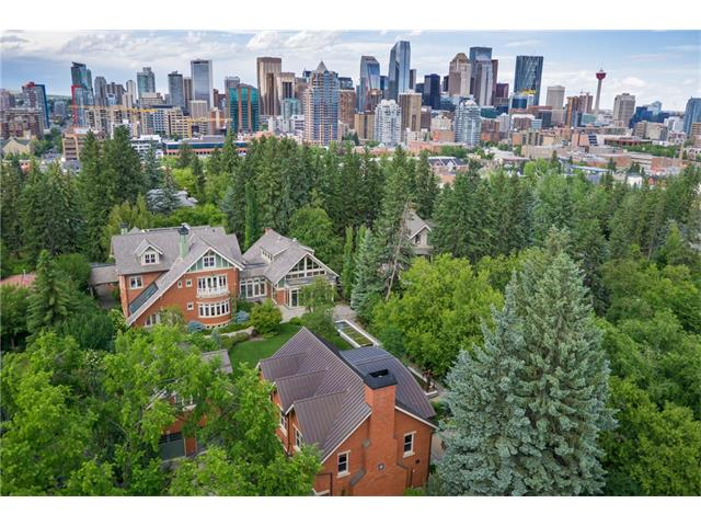 An unprecedented offering. One of a very few truly great estates in Calgary. A perfect blend of history + modernity in brick, sandstone + glass. Magnificently positioned on a 3/4 acre lot, superbly landscaped + manicured, stretching from Durham Avenue at the north to Sydenham Road at the south. Private + secure, just moments from the downtown core.  With over 12,000 ft2 of development, this is one of the largest residences in the inner City. Completely gutted, re-built + expanded...an engineering + construction tour-de-force. Beautiful rooms for large scale entertaining. Luxurious private spaces. Lower level fitness + media. Stunning indoor pool w/ walls that open to the rear yard. Outdoor kitchen/bar. 5 car garage + auto court for an additional 3-4 vehicles. Self-contained guest/staff quarters. Outstanding party/event room. This incredible Estate is the perfect setting for you to enjoy your success + will serve you wonderfully whether relaxing in private or entertaining in grand style.