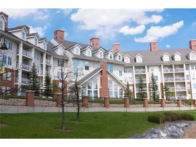 BEAUTIFUL adult living (40+) at Country Estates on the Cove! This meticulous building and unit is sure to impress with its AMAZING AMENITIES and LOCATION.  The well managed building offers an INDOOR SWIMMING POOL, HOT TUB, LIBRARY, PARTY ROOM, GAMES ROOM, WORKSHOP, MOVIE THEATRE, CAR WASH, GUEST SUITE, and a BOWLING ALLEY! This superb 1 BEDROOM condo offers a spacious kitchen with ample cabinet space, eating bar, bright living room, balcony, generous bedroom, and a LAUNDRY ROOM with STORAGE SPACE.  The unit also has an UPGRADED SHOWER with SEAT and GRAB HANDLES. The unit also features AIR CONDITIONING for hot summer nights, 1 UNDERGROUND TITLED PARKING STALL and 1 STORAGE LOCKER.  The condo is in the perfect location for immediate access to the LAKE WALKING TRAILS, SHOPPING, COUNTRY HILLS LIBRARY, and VIVO recreational facility.  The condominium also regularly hosts SOCIAL EVENTS providing a true community feeling.  This unit shows pride in ownership and offers PRIME ADULT and RETIREMENT LIVING.