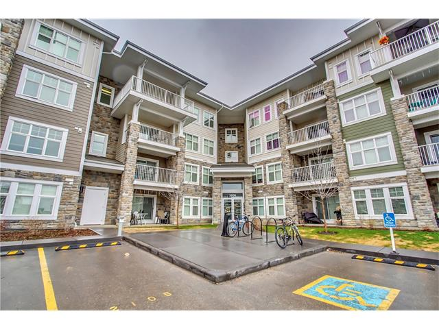 """If you have been waiting for the perfect main floor unit to come on the market in Mahogany; Welcome to 51 Oak built by Truman! A rare main floor, private, south facing unit that doesn't look over the parking lot! (Perfect for a pet owner!) This condo is absolutely stunning and will welcome you the moment you arrive. Bright and airy, with loads of fabulous features this 2 bedroom, 2 full bathroom and den is sure to check all the must haves on your list. Beautiful finishings, an upgraded Frigidaire appliance package, gorgeous cork flooring, quartz countertop with under mount sink, full size stacking in suite laundry, oversized patio with gas hook up, titled underground parking with additional storage unit, and condo fees under $260/month, this condo has it all and is inarguably located in one of the best locations in Mahogany! Within 5 min walk to the Beach Club, the new Village Market, the future """"green line"""" station and a quick commute to Deerfoot or Stoney Trail. Call your favourite Realtor to view!"""