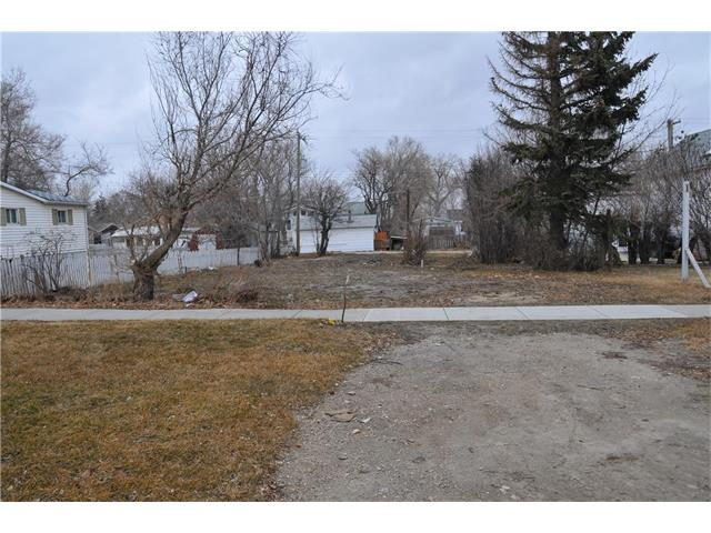 Located on Main Street close to school and stores; Lot ready for you to build your dream home.
