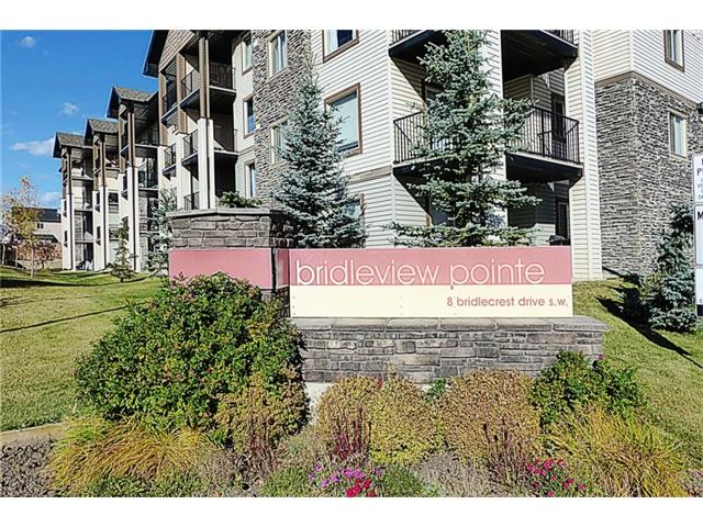 MAIN FLOOR CORNER UNIT - SUNNY WEST PATIO BACKING ONTO COMMON GREEN SPACE. Comes with 2 titled surface parking. Fabulous floor plan (one of the largest) with 2 bedrooms separated by the big bright living room and dining room. The spacious master bedroom features a walk through closet to a full 4-PCE in-suite bath. YES - there is also in-suite laundry with included washer and dryer, and large in-suite storage as well. Be sure to notice ALL THE GUEST PARKING surrounding the green space. Schools, shopping, parks and an excellent family community...If you are looking for that extra special location in a fabulous complex that's in great financial shape at a very very good price, don't just take my word for it, call your agent and get them on it right away!