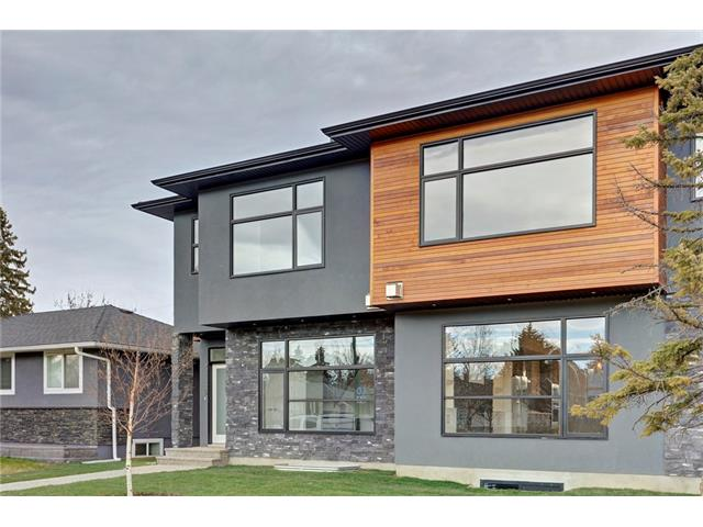 OPEN HOUSE: May 28th 2-4pm. This newly built 2 storey with over 2000ft² above grade is modern in décor and features plenty of upgrades. Main floor highlights include soaring 10' ceilings (level 5) with pot lighting, hardwood floors, quartz waterfall countertop island, upgraded stainless steel kitchen appliances including a wall mount oven and gas cook top, gas fireplace in the living room flanked with built-in shelving and large dining area. Upstairs there is a common 4 piece bathroom, laundry room, 3 large bedrooms including the master bedroom which features a huge walk-in closet with built-in shelving, modern electric fireplace and a 5 piece en-suite with a free standing tub, his and her sinks and a glass enclosed shower with a rain showerhead. The basement features infloor heating throughout, a large rec room perfect for home theatre with speakers, wet bar, a 3rd full bathroom and a large 4th bedroom. Enjoy the privacy in the fully fenced and landscaped back yard with a double detached garage.