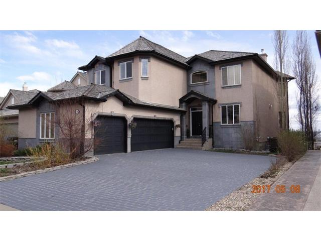 EXCELLENT VALUE LISTED $35,000.00 BELOW CITY ASSESSMENT VALUE, COMPARABLE LISTINGS LISTED IN THE CITY FOR $1,200,000. Luxurious 5 Bedroom home with over 4,500 sq. ft. of living space and unobstructed views of the mountains and city skyline. Open concept main floor with 9ft. ceilings features a beautiful kitchen with granite counters, stainless appliances, pantry and spacious nook. The rest of this floor features a huge dining room and living room separated with a wall unit and cozy double sided fire place. Huge office and 2-piece bathroom complete this floor. The wider stairs to the upper level that features a huge bonus room; huge master bedroom with gas fireplace and a beautiful 6-piece en-suite and a Juliet balcony. 2 bedrooms with walk in closets; 4-piece bathroom and upper floor laundry room complete this floor. Finished walkout basement features 2 extra bedrooms; full movie theatre; wet bar; 4-piece bathroom with in-floor heating; New air conditioning system. Walk out to an S-facing backyard.