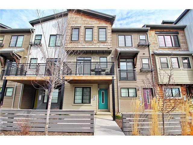 """PRICE REDUCTION FOR OPEN HOUSE this SUNDAY JUNE 25;1:30-3:30pm! CREB RMS size 1006 sqft. but Developers size 1060 sqft. w/o deck.... Welcome to the Vibrant new community of Walden! This """"like new"""" 3 storey town house w/attached double car garage is the perfect starter home or investment property. Open concept layout w/beautiful hardwood flooring & a kitchen boasting Quartz countertops & stainless steel appliances, not to mention 8 foot ceilings tossing around the abundance of natural light. Spacious North West facing patio & deck w/natural gas hook up. Upstairs you find 2 bright large bedrooms & 4 pc bath w/pocket door offering extra privacy as well as upper level laundry. Large double tandem garage w/storage space & extra parking directly out front on Street.Less than 5 minutes walking from several parks,play grounds,schools,public transit & all shopping ameneties not to mention quick access to all major roadways connecting you city wide, EVEN better are the super low Condo fees!Close to Fish Creek Park."""