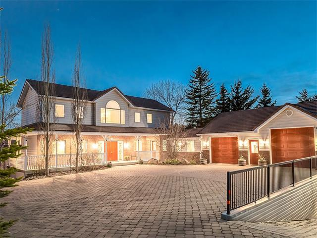 ONE OF A KIND WALK-OUT home on 1996 sq mt PARK-LIKE SETTING in a SECLUDED ESTATE of Dalhouise w/over 7371 sq ft of living space + AWESOME attached HEATED 8 car QUAD garage w/LOWER BAY! Tons of features you will LOVE inc MOUNTAIN VIEWS, CROWN MOULDINGS, STAINED GLASS doors, NEW OVER-SIZED H20 tank, IN-FLOOR HEAT, AIR FILTRATION SYSTEM, MATURE TREES + SHRUBS in the BEAUTIFUL yard + more! The main floor has a HUGE WRAP-AROUND PORCH, foyer w/storage, formal living rm, family rm w/CORNER FIREPLACE, dining area + BEAUTIFUL kitchen w/country style cabinetry + CORIAN counters. An office, BIG laundry rm + mud rm complete the main level. Upstairs is a HUGE UPPER DECK, bathroom + 3 GOOD SIZED bedrooms inc the Master Suite w/WALK-IN CLOSET, EN-SUITE w/AIR TUB + DUAL VANITY! The basement is FINISHED w/3 addl BEDROOMS, bathroom, REC area w/CORNER FIREPLACE + ROUGH-IN for wet bar, flex rm + TONS of STORAGE leading to the LOWER GARAGE! WALK-OUT to the BEAUTIFUL PATIO w/HOT TUB + GORGEOUS YARD! You MUST see to BELIEVE!!!