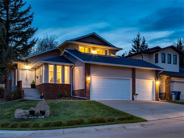 BEAUTIFULLY RENOVATED home w/over 3057 sqft of living space + TRIPLE ATTACHED garage on a 591 sqmt CORNER LOT in a GREAT location in POPULAR NORTH HAVEN super close to NOSE HILL PARK + WINTER CLUB! Over $100,000 spent on GORGEOUS renos inc HARDWOOD floors, NEW WINDOWS, NEW energy star H2O tank, NEW KITCHEN, NEW BATHROOMS + more! The SPACIOUS main floor has SOARING VAULTED ceilings, an OFFICE, living rm w/GAS FIREPLACE, dining rm, family rm w/GAS FIREPLACE + doors leading to the AMAZING 2-TIER deck! STUNNING kitchen w/BRIGHT WHITE cabinetry, QUARTZ counters, STAINLESS STEEL appliances inc INDUCTION STOVE + LARGE ISLAND! Laundry rm + half bath complete the main level. Upstairs is a bathroom + 3 GOOD SIZED bedrooms , 2 sharing a BALCONY + the Master Suite w/BEAUTIFUL EN-SUITE with DUAL sinks + WALK-IN shower w/SUBWAY TILE! The basement is FINISHED w/a bathroom, 2 addl BEDROOMS + HUGE family rm area! GORGEOUS WEST facing yard w/MATURE TREES, landscaping + fully fenced! MOVE-IN READY so call to VIEW TODAY!