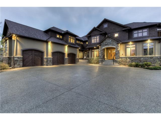 This home, designed by McKinley Masters, has it all: 5100sf ABOVE GRADE, 5 BEDROOMS all with ENSUITES. The main floor boasts an Empire Kitchen with Wolf dual oven, Miele coffee maker, concealed Sub-Zero fridge and freezers. There is an oversized dining room with butler?s pantry, South facing living room and an office with exquisite walnut millwork. Upstairs, the MASTER RETREAT has a sitting room with fireplace, plus his and hers closets off the luxurious ensuite. Two additional bedrooms and a large guest/nanny suite complete the second level. The lower level games area and theatre are complemented by a full wet bar w/ DW & dual Sub-Zero beverage fridges. Additionally, you will find a 1000-bottle, temp controlled wine cellar, massage room and 5th bedroom. Extra features include: new ELAN full automation system (lighting, music, media, security), lighting designed by Bocci, new 10? hot tub, heated triple car garage with over-height lift, hand-forged wrought iron stair case and motorized window coverings.
