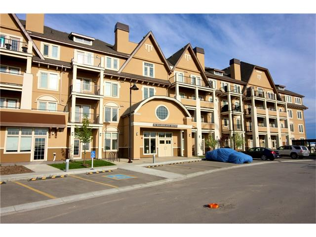 """Lakeside living at its finest! New & never lived this unit comes w/ full builder & ANHW. Sandgate has been expertly designed to be rich in character, design & liveability, both inside your home & outside. Why rent when you can own and live in Calgary's top communuty. 22km of pathways, 2 beaches, a plethora of commercial amenities, green space, playgrounds, pets welcome, a fitness studio, lending library & guest suite. Built by Multi-Family Builder of the Year. This unit offers 1 1/4"""" Quartz counters in kitchen & bath, 42"""" """"Iron Ore"""" kitchen cabinets, 10' knockdown ceilings throughout, Soft-close drawers & doors, Spacious laundry room with full-size washer & dryer, Stainless steel Whirlpool appliances, Sunny patio w/ gas line for your barbecue, Window coverings & A/C rough-in. Open design kitchen, central dining area & back lifestyle room. Laundry & added storage just off the entry & the main 4pc bath offers a cheater door from the master bedrooms walk through closet plus a full width patio!"""
