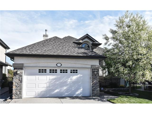 IMMACULATE BAY WEST 2005 BUNGALOW, 1710 SQ FT, 1+2 bedrooms ,over 2780 sq ft of living area, backing on BOW RIVER PATHWAY, GREEN SPACE, WALKING PATH, leading to the RIDGE. Enjoy the stunning MT VIEW fr your deck. VAULTED KNOCKDOWN CEILINGS. Lots of NATURAL LIGHT. Well designed, open plan. GLEAMING HARDWOODS. Inviting spacious foyer. Lg dining area, great for family dinners.  Cooks will love the WALK-THROUGH PANTRY in the kitchen +  SS appliances, raised eating bar w/GRANITE TOP.  Enjoy you morning coffee in the eat-in kitchen overlooking the backyard. Features a Stone faced DOUBLE sided GAS FP in the Great Room. Generous MASTER SUITE+ 4Pc ENSUITE,  room for king bed.  PRIVATE MN floor office & laundry.  Beautiful curved staircase leads to PROF DEV bsmt w/2 zone HEATED FLOORS,  2nd GAS FP, spacious FAMILY rm, GAMES area, (room for pool table), 2  LG BEDROOMS, 4pc bathroom, 9 FT KNOCKDOWN ceiling, lots of storage. Mature landscaping, back deck w/GAS line for BBQ. Just move in & ENJOY this fine home!