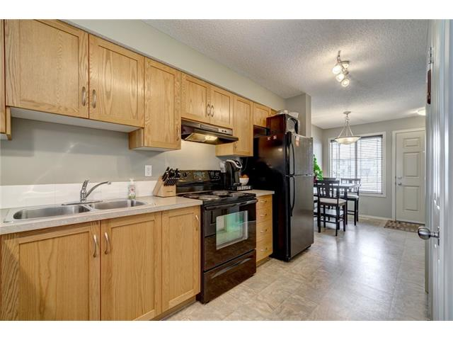 If you are looking for the best deal around you have found it.you own) 2 BEDROOMS AND 2 BATHROOMS PLUS 2 PARKING STALLS, ONE IS TITLED. This is a bright end unit with bedrooms below but don't let that deter you. You get no noise from neighbors when you try to sleep and it's nice and cool in the summer and cozy in the winter. The on demand hot water system warms the basement and it offers savings for energy. The complex is well ran and pets are allowed. If you want to get into the market and stop paying rent this is the perfect opportunity. Calgary is already heating up and once it does you'll wish you would have made the move. TOTAL COST TO OWN THIS PLACE WOULD BE UNDER 1200$ INCLUDING ALL UTILITIES, TAXES AND CONDO FEES. CALL TODAY FOR DETAILS.
