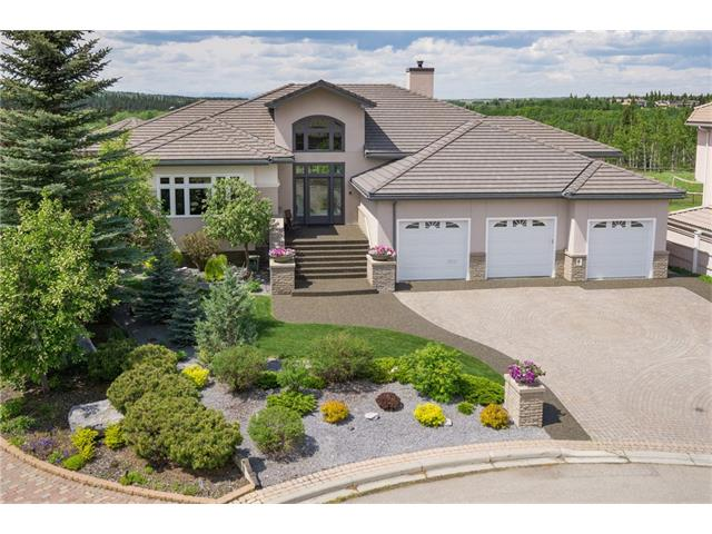 Located on the most prestigious street BACKING FISH CREEK PROVINCIAL PARK! Stunning VIEWS of the PARK, VALLEY & ROCKY MOUNTAINS.  First time on the market! This WOODACRES ESTATE WALK OUT BUNGALOW has a QUAD GARAGE & offers over 6000 sq ft. for living & entertaining. The main floor features an 18ft. vaulted entrance and 10 ft. CEILINGS throughout. There is a chef's kitchen & dining room that seats over 12 & a lower level that has a huge family/recreation room with bar, wine room, Incredible SUNROOM as well as a separate 8 person Indoor Hot tub/Exercise room.  There are 4 bedrooms, 3.5 baths, a huge main floor office that can double as a 2nd bedroom, a large walk in entry closet designed to host an elevator, large powder room & grand lower level  with 9 ft. ceilings.  The lower level also has a library, the family room with 65in. 3D T.V. & the sunroom that opens or can be screened in to enjoy the serene backyard & extension to the park.  See brochure & video for more detail.
