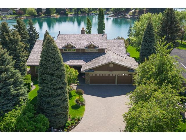 THIS IS IT...THE MOST COVETED LOT IN LAKE BONAVENTURE ESTATES! ONE OF THE LARGEST LOTS (2160 M) WITH OVER 150 FEET OF WATER FRONT.  This gated 6975 sq ft Lake front walkout bungalow with a loft offers a magnificent landscaped private yard, heated in-ground pool, hot tub, pavilion and your own private dock. The home features 5 bedrooms, 5 bathrooms and 3 fireplaces. The main floor has 23 ft vaulted ceilings, floor to ceiling windows overlooking the lake and a grand spiral stair case. The kitchen features granite, subzero fridge, double ovens and a recessed ceiling with lights. The living room features a spectacular stone fireplace and extra large windows with amazing views of the lake. All of the bedrooms are very large with most of them having their own ensuite. The main floor den has coffered ceilings with built-ins. The lower level walkout features a family room, 3 bedrooms, games room, bar and a stone fireplace. This is a spectacular home that words cannot describe. A MUST SEE!!