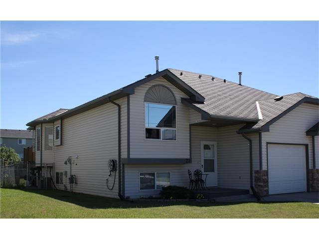 This Bi-Level home has over 1700 SqFt of usable space.  The open concept main level with kitchen, eating area and living room have commercial grade laminate flooring, which will stand up to kids and pets. Vaulted ceilings in living area and master bedroom give it a spacious feel. Master bedroom, with walk thru closet and four piece ensuite with jetted tub, faces the back for quiet and privacy. Completing the main floor is an additional bedroom, main floor laundry next to a large storage closet, and a guest bathroom.  