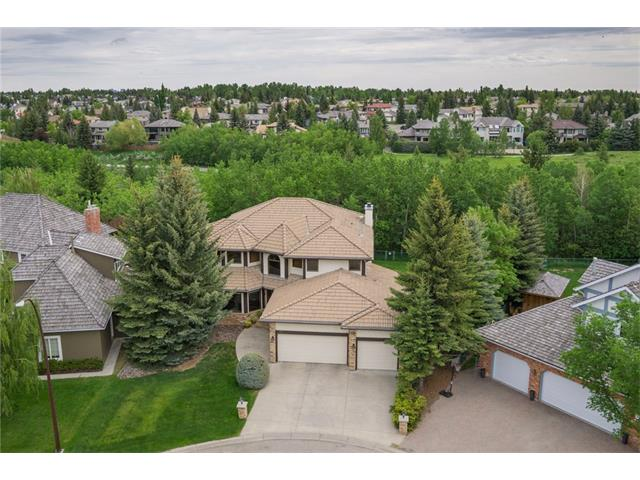 Absolutely incredible lot & location backing on to Fish Creek Park! Not often does this type of location & quality of home become available. This is an exclusive, private & beautifully landscaped lot at the end of a prestigious cul-de-sac. At nearly 3300 sq ft above grade & almost 4800 sq ft of developed space, this is an estate home that appeals to established or growing families. This semi-formal plan is also great for entertaining. Large principal rooms across the main, & very large bedrooms up & down (4+1). The master features a walk-in closet & a huge 5pc ensuite. Full  basement with rec areas, bar & lots of storage. Lots of windows provide for ample natural light & allows you to enjoy the view. Triple garage. The true distinguishing feature of this property is the lot & location. 11,250 sq ft of land & a yard large enough for any activity. If you're seeking sun or shade, a yard this size offers it all. Relax on your back deck or soak in your private hot tub. Walk-out your yard to Fish Creek Park!