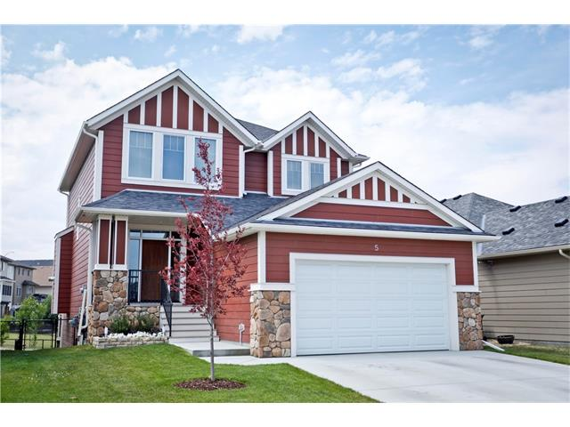 """Please click on """"Multimedia"""" for 3D tour. Total pride in ownership, upgrades galore and move-in ready is the best way to describe this fabulous 2 Storey that backs WEST onto a GREENSPACE! Features include: in-floor/in-slab heat, """"Hardie"""" board siding, walkout basement, new roof (2017) - hail resistant shingles, hardwood floors, large yard that backs onto the large part of the green space, upgraded """"Kohler"""" plumbing package, large bonus room, solid wood built-ins, upgraded SS """"Smudge-Proof"""" appliances, luxurious master en suite bath with stand-alone soaker tub & over-sized shower, 9 ft ceilings on main & basement, quartz counter tops throughout, oversized/insulated double garage, good sized """"Dura"""" deck & much more! Location is outstanding - blocks from schools, right on the pathway system, 2 blocks from Costco/Home Depot/Save-On Foods, walking distance to the Sheep River & only 15 minutes to Calgary! Kunz homes are a cut above the rest - dare to compare!  Balance of AB New Home Warranty.  Original Owners!"""