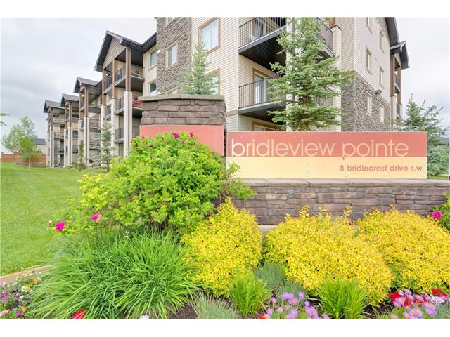 Spacious & inviting 2 bedroom apartment located on the 2nd floor of Bridlecrest Pointe. Established community of Bridlewood. Elegant south facing condo with large balcony looking out upon landscaped courtyard. Upgraded floor package: laminate & tile throughout, 6 piece appliance package, 2 full baths, hunter-douglas window blinds, modern light fixtures + titled underground parking. Very well managed condo complex has abundant visitor parking & easy access to fish creek park, empire theater, golf club & Golf course.  Variety of shopping amenities just mins away: Sobeys, Shoppers drug mart,  Superstore, Co-op, Safeway, Wal-mart, Home depot, Staples, Bestbuy & Canadian tire. Popular area has all you would want: C-train just minutes away. With a condo fees of just $329/month rest easy knowing your expenses will fit your budget. Close proximity to schools, parks, recreational facilities, & easy access to major roads makes this a perfect Home-base For Busy Lifestyle Oriented Buyers