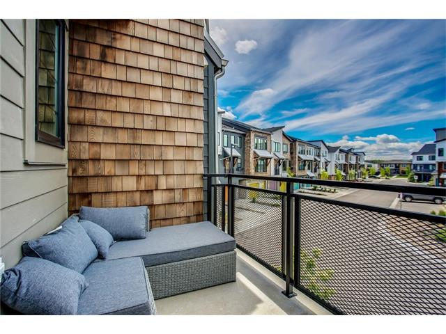 NOTE PRICE ADJUSTMENT!! This unit is the perfect place to call home!  Below market value, this beautiful unit has all the upgrades - granite, tile, hardwood... the list goes on.  Nestled in a quiet area off the main street, this home is within walking distance from shopping, banking, pubs and other amenities as well as a beautiful park and green space.  Enjoy yourself at the end of the day while sitting on the lovely deck enjoying the lovely views.  Don't miss it!