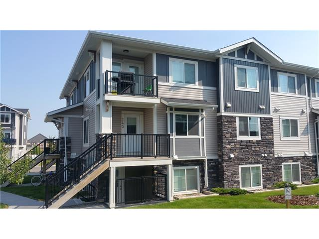Fantastic 2 bedroom condo located in desirable Chestermere Station. This condo is just steps away from all of the Shopping and Amenities you could want in Chestermere, including the Lake. This 2nd floor, open concept, corner unit is ready to move in or alternatively to keep as a fully managed investment property with a long term tenant in place. Built in 2012 this condo shows very well with neutral paint colours, open concept design, kitchen island and black appliance package, in suite laundry, an assigned parking stall, and low condo fees of under 130 dollars a month (each unit has their own furnace and hot water tank); this is amazing value in the town of Chestermere. This complex allows pets and you may have up to 2 cats or 2 dogs or 1 of each. Note: Most photos are from a vacant unit, this unit has laminate floors throughout. Call your favourite Realtor to book your showing today!