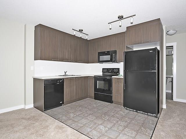 Welcome to Chestermere Station! Come out and have a look at this fantastic 2 bedroom condo located just steps away from all of the wonderful amenities the area has to offer including the lake, shopping, coffee, restaurants, pathways and parks, just to mention a few. This 3rd floor, open concept, corner unit is ready to move in (or alternatively to have as a fully managed investment property). Built in 2012 this condo shows very well with neutral paint colours, L shaped modern kitchen design, black appliance package, in suite laundry incl extra room for storage, low condo fees of under 140 dollars a month (each unit has their own furnace and hot water tank), and an assigned parking stall. This condo complex allows pets and you may have up to 2 cats or 2 dogs or 1 of each, birds in a cage and fish in a tank are just fine too. It doesn't get much better than this. Call your favourite Realtor and book your private showing today!