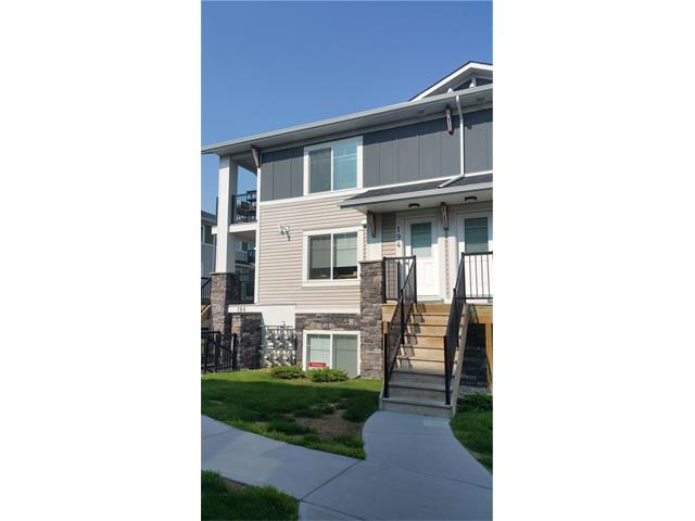 Fantastic New listing! 2 bedroom condo in Chestermere Station; this 3rd floor, open concept, corner unit is ready to move in (or alternatively to have as a fully managed investment property). Built in 2012 this condo shows very well with neutral paint colours, L shaped modern kitchen design, black appliance package, in suite laundry with extra room for storage, low condo fees of under 136 dollars a month (each unit has their own furnace and hot water tank), and an assigned parking stall. This condo complex allows pets and you may have up to 2 cats or 2 dogs or 1 of each, birds in a cage and fish in a tank are just fine too. Located just steps away from all of the wonderful amenities the area has to offer including the lake, shopping, coffee, restaurants, pathways and parks, just to mention a few. It doesn't get much better than this. Call your favourite Realtor and book your private showing today!