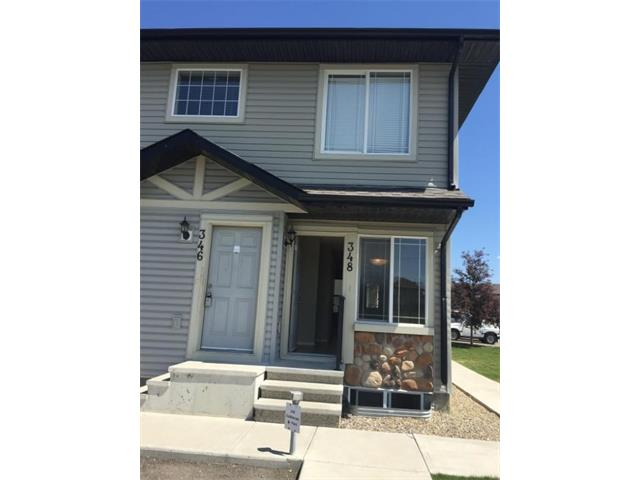 OPEN HOUSE SUNDAY 2.00TO4.00P.M. Reduced ANOTHER 5k for Quick Sale !!!!!  Corner LOT  !Why Rent ,when you can Own less then 1k per mounth , well maintained ready to move in -  make this your future home ,Equity builder with 2 parking one titled in-front of the unit, 2 bedrooms with en-suite laundry and lots of storage with your own two levels of living washroom with tub ,Tank-less hot water system,and sunshine all day,With Over 800 sqfeet of developed living area !!!!Block from school, VACANT FOR EARLY POSSESSION !!! Calgary  Transit outside the Condo Complex !! All professionally cleaned just move in !!!