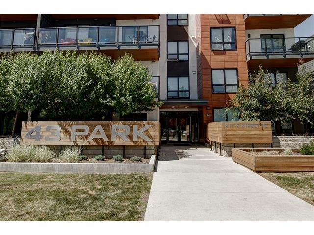 Shaa-Sweet Boutique Apartment! 43 Park, across from Bridgeland Park! Beautiful 1 Bedroom plus FLEX room in the Beautiful 43 PARK building. Space is not in issue in this large, South-facing, bright and sunny home. Beautiful  kitchen w/Quartz counters, FULL SIZE stainless steel appliances, built-in MW, soft-close drawers & doors, 10 foot island (also acts as dining table). Open living room facing south opens up to 10x10 foot private balcony offering cozy privacy and gas for your BBQ. Large Master Bedroom with huge closet and BRAND NEW spa-like 5 piece ensuite w soaker & shower(10 mil glass!), dual sinks & private water closet. The front room is excellent for relaxing or study. Hardwood plank LVT flooring and tile throughout (no carpets!).The unit has a huge front closet, in-suite washer and dryer; also includes 1 secure, heated, underground parking stall. The building boasts a full gym, visitor parking & the convenience of Renfrew/Bridgeland, and walking distance to lots of amenities! Come view Today!