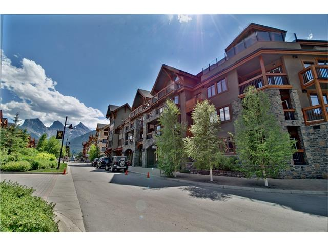 Located just a short walk to Canmore's Main Street, this spectacular 2 bedroom, 2 bathroom Spring Creek condo shows like new. Granite countertops, stainless appliances, Australian Cypress and slate flooring, huge covered wrap-around deck, and plentiful windows to make the most of this quiet, park-like setting. Heated by environmentally conscious ground-source heat pump. This unit comes with two side-by-side titled underground parking stalls and secure assigned storage locker for your mountain gear. A terrific opportunity at this price!