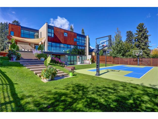 """Stunning, cutting-edge modern architecture by globally recognized Seattle architect Tom Kundig (Architectural Digest ?Top 100?). Fantastic ridge lot in prime Mount Royal location (90? x 162?). Private at the front, nearly all glass at the rear. Casual + easy living plan that works great for entertaining or family living. Open kitchen, dining + great room across the rear w/ floor to ceiling, wall to wall windows w/ great views incl the City skyline. Huge view terrace has steps down to the yard. Total of 5 bedrooms, 6.5 baths, 2 family rooms + triple attached garage (auto court for additional 3 vehicles). Lower level is full walkout. 5600+ ft2 built to commercial standards by Triangle Enterprises: concrete construction, 12"""" thick exterior walls, triple glazed commercial windows + fantastic infrastructure. Professionally landscaped + fully fenced w/ power gate. Just a few blocks walk to top schools, 17th Ave/4th St villages + downtown. Outstanding value, offered at far below replacement cost."""