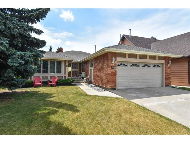 PRICE REDUCED WILL NOT LAST NOW ACT FAST!!!, Well maintained walkout bungalow with great views of city, Olympic Park, & Rockies. Stucco and ?used brick ?exterior with covered deck, adjacent to Ranchero Park & playground. Within easy walking distance to all Crowfoot amenities, Crowfoot LRT, YMCA, library and Robert Thirsk High school. 2 wood burning fireplaces, 2 bedrooms on main floor & 2 large bedrooms lower level. Upgrades include kitchen, one of the 2 furnaces, ?on demand? hot water system, lower tub & surround, new roofing, eaves troughs & gutters, sump pump, garage door, rear fence, attic insulation, deck flooring & venetian blinds. All windows were replaced to ?low E? in 2015. Double garage is extra-long with workspace & storage.