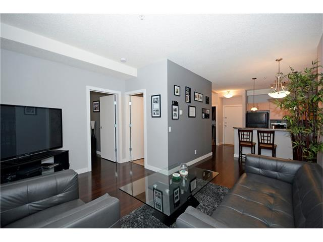 Conveniently located on a quiet street in a cul de sac just minutes to downtown,Calgary Zoo,trendy shopping district in Bridgeleand,LRT and many other amenities this location is hard to beat.This beautiful one bedroom plus den unit offers a modern open concept floor plan with 9FT ceilings and floor to ceiling windows providing plenty of natural light and backs onto a treed greenspace.The kitchen is spacious and offers maple shaker cabinets,breakfast bar,black appliances and plenty of counter space.The den was converted to a walk-in closet with custom built-in shelving providing ample storage,it can easily be converted back to a home office if desired.A garden door off the living room opens to the large private balcony to enjoy the view of the park setting.Other features include a heated underground parking stall (titled),in-suite laundry,brazillian cherry hardwood floorsand gas BBQ line on the patio.Well managed and maintained,secure complex this unit is a must see!
