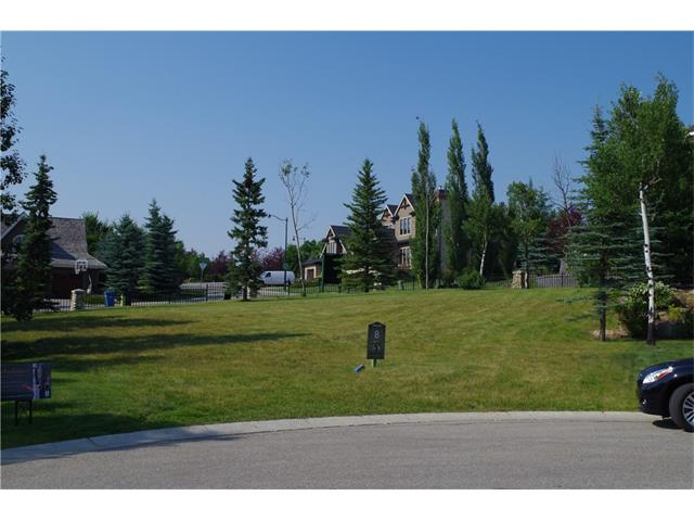 One of three remaining lots available in one of Calgary's premiere gated communities, Spring Valley Lane. This 10,000 square foot lot can easily accommodate a walk up bungalow.  Design your own home or Legend Developments can design and build it for you or bring your own builder, some restrictions do apply for the complex.  This bareland condominium complex includes your grass cutting and snow removal in the winter, for only $200 per month. Mountain views from balconies.  Don't miss the great deal on this large lot. Call today and come have a look.