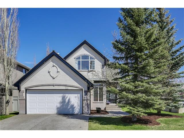 Just steps from the ridge overlooking Fish Creek, this former Albi Showhome with 4 bedrooms and 4 full bathrooms on a corner lot has plenty of upgrades and is the perfect place to call home! Main floor highlights include gleaming hardwood floors and corner gas fireplace with a decorative coved ceiling in the front room, maple kitchen cabinetry, granite counter tops, upgraded recessed sink with newer plumbing fixtures and water filtration system, subway tile back splash and a four-burner gas stove. The main floor also features a large flex room which could be used as an office or bedroom and also offers a 3-piece bathroom. Upstairs there are two spacious bedrooms including the master with vaulted ceilings, plenty of closet space and an en-suite with a deep jetted tub and separate shower. The lower level is fully finished with a rec room, 4th bedroom, 4th bathroom and has plenty of storage. Enjoy the summer on the deck in the fenced and landscaped yard!