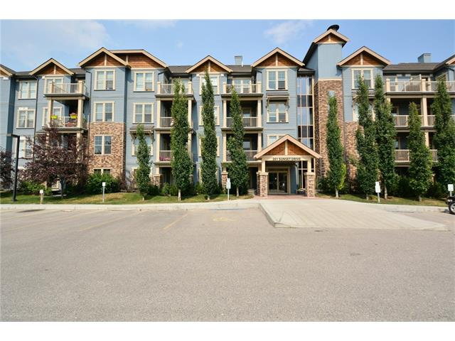 Located in Sunset of Cochrane. This main floor unit shows pride of ownership. The upgrades & features include: hardwood, tile, stainless steel appliances, en suite laundry, patio & 1 titled parking stall. The unit features a spacious living room that has door that leads to patio & green area, kitchen that offers lots of counter space, work station for computer, 4pc bath & a good size master bedroom. There is also a fitness centre to use which has treadmill, elliptical, stationary bike, free weights, weight benches, leg press, shoulder press & a stretching area. The building also offers a suite for guest to rent at 50.00 per night. Close to green spaces, shopping & all other amenities & easy access to Banff & Calgary. Condo fees only 259.90 per month. Click on multi media to view 360's.