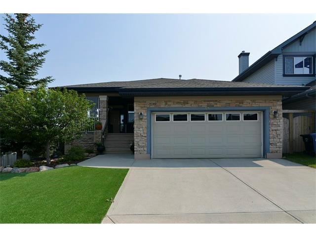 ** Open House Sunday July 20 1-3pm ** Welcome to Panorama Hills, this former SHOWHOME BUNGALOW is sure to impress with over 2600 sqft of living space!  This is how a bungalow should be designed!   Pride of Ownership - 3 bedrooms, builder finished WALKOUT with a professionally installed SYNTHETIC LANDSCAPED YARD, protective front porch and double attached garage. Main floor features an abundance of  natural light w/ extended windows, open layout living space with a stone surround gas fireplace, hardwood floors, custom kitchen cabinets, granite countertops, large centre island, black appliance package (Fridge, stove, dishwasher inc), an enclosed office and laundry room. Master bedroom has a huge walk-in closet + ensuite w/ dual sinks, walk-in shower and soaker tub. Extended windows in the lower level, 2 large bedrooms, a full bathroom, gas fireplace and custom built-in shelving perfect for entertaining.  Retractable awning, stone patio and best of all private backyard.