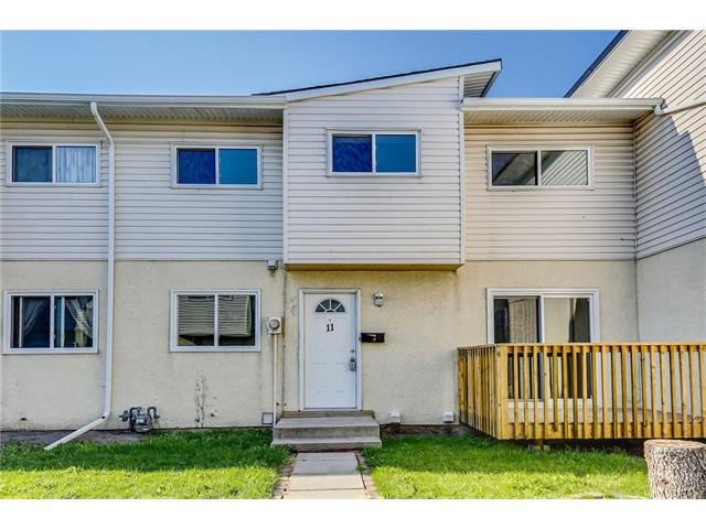 Here's your chance to enter the market with this wonderfully renovated 3 bedroom townhouse in the well maintain and managed development of Forest Glen Gardens! Highlights of this freshly painted home include new carpet throughout, newer lighting fixtures, updated plumbing fixtures, newer windows, a spacious living room with a sliding patio door leading to a private deck, plenty of storage and cabinetry in the kitchen with newer counter tops and tile back splash, a half bathroom on the main level, 3 spacious bedrooms upstairs with ample closet space and a four piece common bathroom. The lower level has lots of potential for development and offers room for storage. This unit also comes with an assign parking stall. Located close to the schools, parks, playgrounds, shops and public transit makes this a great location to call home. Call to view today!