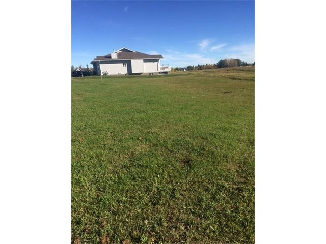 This vacant lot is approved for an attached villa condo with a DOUBLE garage and balcony.  The adjoining lot is approved for a SINGLE garage villa. Plans must be submitted to the condo board for approval before building.  BRING YOUR OWN BUILDER!  The Ridgestone is a wonderful 45+ adult community composed of 48 Villa units, 20 Garden Suites and a Lodge - a living in place concept.  Shopping and restaurants are within walking distance and the Hospital and Long Term Care across the street to the north.  Curling, Skating,fishing and community clubs are also in the neighbourhood.  Big box stores are 15 minutes away and Kananaskis recreation just a short drive west.