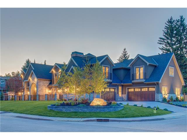 This grandeur home is located in the sought after community of Willow Park. Sitting on a 120x100 ft property, this 6237 sq ft home is nothing short of exquisite. With an extremely well thought out floor plan, the home developer, Elevation Luxury Homes left no luxurious detail spared. Entering the double arched doors, you will find yourself in awe of the grand curved staircase and spacious, open floor plan. The kitchen is fitted with handmade cabinets and Miele appliances including a professional range, double fridge and freezer, as well as a built in espresso maker and wine fridge. The main floor master bedroom is spacious and luxurious with double wide doors walking out onto a private outdoor living space. An outdoor fireplace allows for year round use of this space and the automatic shades offer privacy indoors or out. The master retreat continues on into the ensuite with large glass shower, free standing tub and double vanities. The spacious walk in closet includes the convenience of separate laundry.
