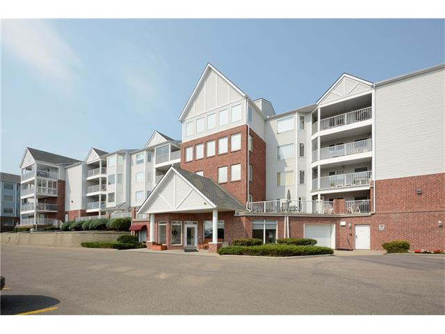 A great opportunity for adult 50+ living at Dreamview Village. This spacious two bedroom apartment features a large living room/dining room area with bright windows and french door to the balcony; oak kitchen and breakfast nook with access to a second balcony (with gas line for BBQ); huge master bedroom with a three piece ensuite and his and her closets; in-suite laundry and storage room; numerous extra built-ins; titled underground parking and assigned storage locker. This complex is located in a wonderful park like setting with ample greenspace; walking paths pond with fountain. The clubhouse offers kitchen and banquet room, pool tables, shuffleboards, darts, social area and wrap around deck with mountain views.