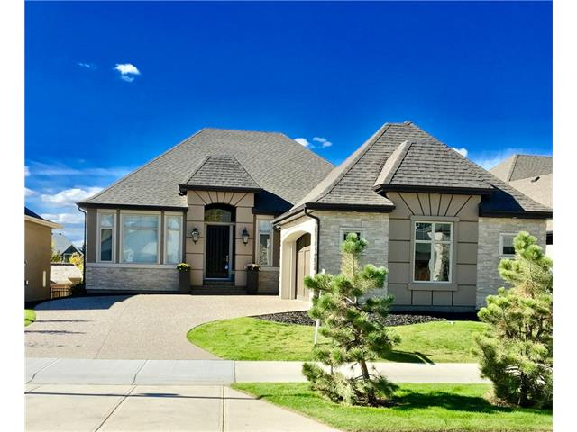 "Magnificent Home in Riverstone! 2250 sq ft Bungalow with great attention to detail, plotted on a choice lot on the widest part of the green space leading to the Bow River. Elegant finishing?s are showcased thru-out this thoughtfully DESIGNED home w/over 4000 sqft of elegant living space. Gourmet kitchen, walk-thru butlers pantry, 36"" Viking cook top, Fisher&Paykel built in fridge & high-end Stainless Steel appliances. The large dining room connects to the butler's pantry & the nook w/large windows leads onto the south facing deck with covered roof. The large masters' retreat & luxurious spa-like ensuite exude comfort & opulence. The main floor office/music room complete the upper level. The lower level is tastefully developed w/2 spacious bedrooms, 4pc bath, media, & entertainment wall & large windows encompassing the beautiful outdoors. Triple side drive garage, $200,000 plus in upgrades and more will make you never want to leave! Come enjoy Riverstone today!"