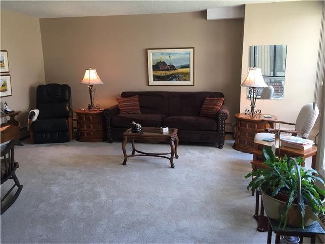 """Wonderful opportunity to move in and enjoy this spacious condo!  Features include 2 bedrooms, 2 baths, den, in-suite laundry, large master with walk-in closet and a 4 piece ensuite, formal dining room and an updated white kitchen!  Located in popular """"Bayshore Park"""" this super location is close to shopping, Glenmore Park, transit and restaurants.  Amenities in this concrete building include a library, boardroom/party room, shuffleboard/pool table, fitness room with sauna and air-conditioning.  There is a 25+ age restriction and no pets allowed. Underground parking stall and separate storage unit."""