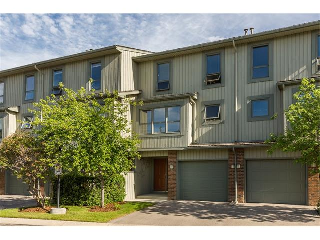 If you have an active lifestyle this unit is steps away from walking paths & Fish Creek. It is easy to go west & head for the hills. The complex is beautiful & well maintained. The single attached garage is extra deep to fit your SUV, bikes or even a workshop area. As you enter you will notice the durable aggregate floor & large foyer. Make your way up to the living room with large windows & a soaring ceiling. There is a stone fireplace & a garden door out to your sweet back deck & green space. Entertain in the large dining room with gleaming hardwood floors. The kitchen is bright & cheery & it has a ton of counter & cupboard space. Upstairs you will fall in love with a huge master bedroom with 2 large closets & a stunning renovated ensuite. The secondary bedrooms are also generation & there is another renovated full bathroom. The basement has plenty of storage, a new hot water tank & there is recycling in the complex. This owner has loved this home for 23 years but is now ready to downsize.