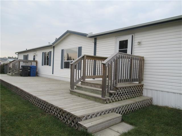 Wonderful 1216 sq ft mobile home sits on 43' x 128' lot!  Home features 2 nice size bedrooms, another bedroom could be added quite easily, by putting up a wall. Other development included in this home built in 2000, is 2 4 piece bathrooms, and open concept kitchen, dining area with built in china cabinet, and huge living room. Yard is completely fenced with a double gate off of the alley to park an R.V. All appliances are included and also a garden shed. Why pay rent, this is a good stepping stone to owning your first home or for down sizing! Call today!
