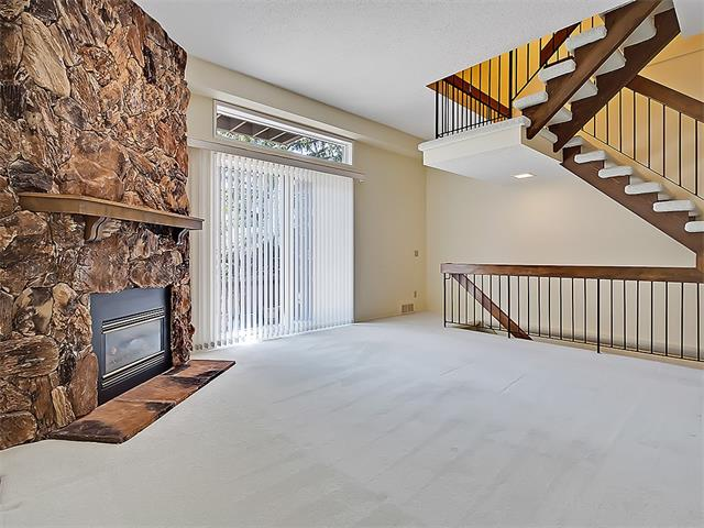 **Seller will entertain all offers**Arguably the most sought after Briarwood model in phase 3 of Lakeview Green. This is an end unit & includes an oversized heated garage. The main floor offers a spacious kitchen, oak cabinets, half bath, formal dining room that over looks the vaulted living room, just waiting for you to put your personal touches on. Bright south facing windows lead to a private fenced patio. Upstairs you will find 2 large bedrooms, 2 full bathrooms & laundry for your convenience. The lower level provides plenty of storage as well as access to the oversized garage. This is a super location for schools, Glenmore Park, off leash dog park, Mt Royal University & public transit. Shopping is just a few blocks away! Call to book a viewing.
