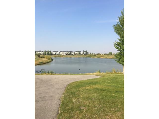 Location Location Location ......beautiful 2 bedrooms plus den condo, across from a big pond! As you enter you will find a den and 2pce bathroom off the garage. The main floor is upgraded with very durable laminate flooring throughout the kitchen, dining and living room area. Beutiful open concept kitchen with nice granite, Loads of counter and large center islands/ bar centrally located with stainless steel appliances,  built in microwave oven and more...... The living room has access to one of the largest balconies in the complex, complete with natural gas. Upstairs are two good sized bedrooms with a full ensuite off the master bedroom.  Beautiful view of the pond from all level of this gorgeous home................................
